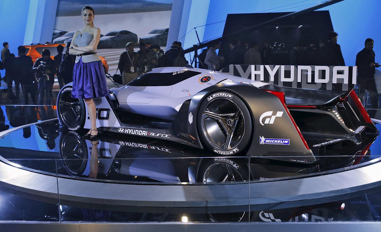 """A model poses next to Hyundai sports concept car """"Muroc"""" at the Indian Auto Expo in Greater Noida, on the outskirts of New Delhi, India, February 3, 2016. REUTERS/Anindito Mukherjee"""