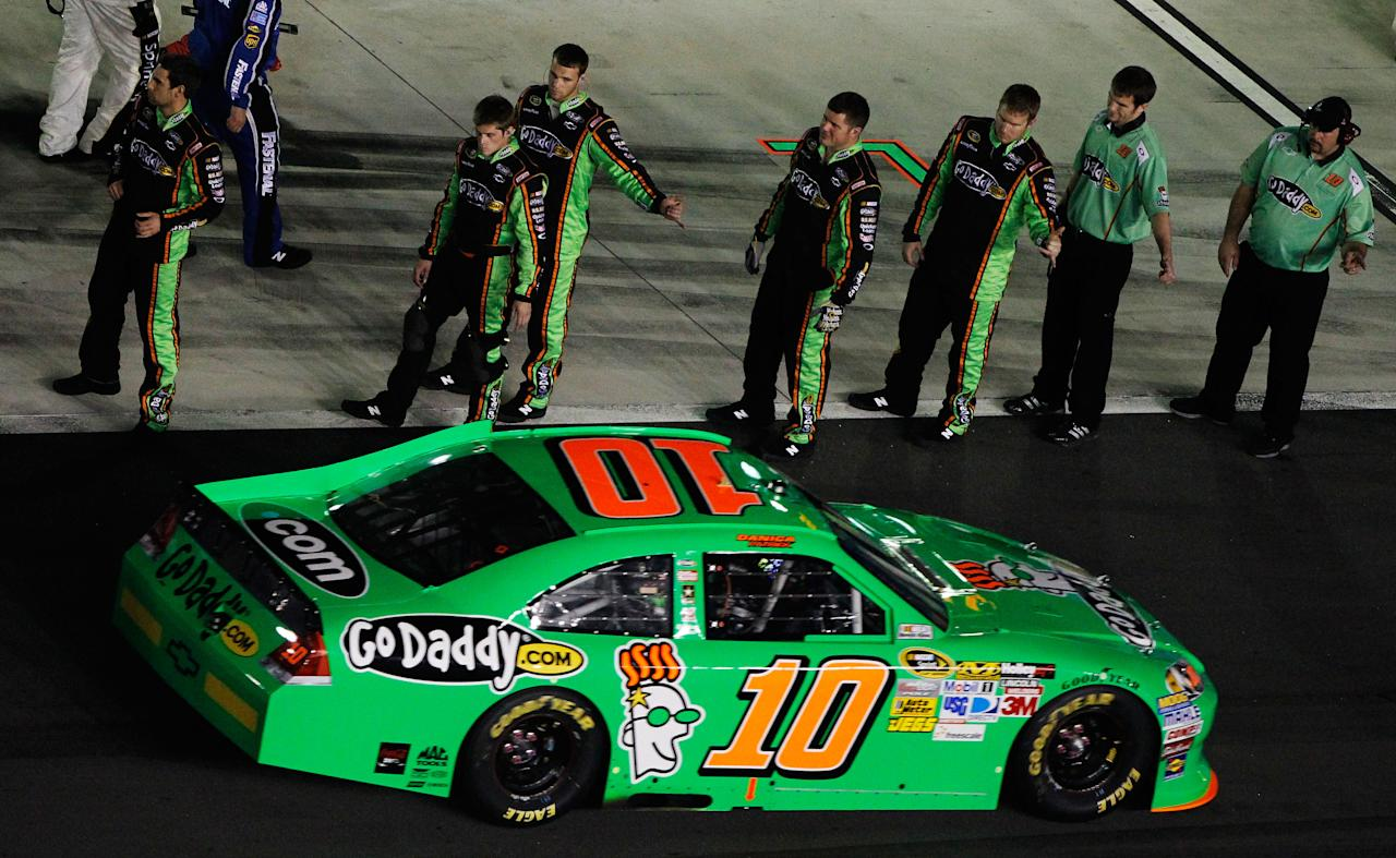 DAYTONA BEACH, FL - FEBRUARY 27:  Danica Patrick, driver of the #10 GoDaddy.com Chevrolet, drives past her crew on the grid before the start of the NASCAR Sprint Cup Series Daytona 500 at Daytona International Speedway on February 27, 2012 in Daytona Beach, Florida.  (Photo by Tom Pennington/Getty Images for NASCAR)