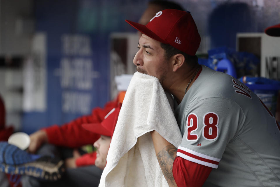 Philadelphia Phillies pitcher Vince Velasquez sits in the dugout after being relieved in the fifth inning of a baseball game against the New York Mets, Sunday, Sept. 9, 2018, in New York. (AP Photo/Mark Lennihan)