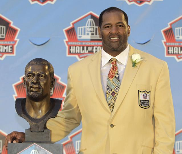 FILE - In this Aug. 6, 2011 file photo, Richard Dent poses with a bust of himself during induction ceremonies at the Pro Football Hall of Fame in Canton, Ohio. A group of retired NFL players says in a lawsuit that the league illegally supplied them with risky painkillers that numbed their injuries and led to medical complications. Attorney Steven Silverman says his firm filed the lawsuit Tuesday, May 20, 2014, in federal court in San Francisco. The eight named plaintiffs include Hall of Fame defensive end Dent and quarterback Jim McMahon.(AP Photo/Tony Dejak, File)