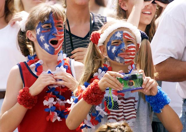 USWNT fans cheer during a 1999 first-round Women's World Cup game against Denmark. (TIMOTHY A. CLARY/AFP via Getty Images)