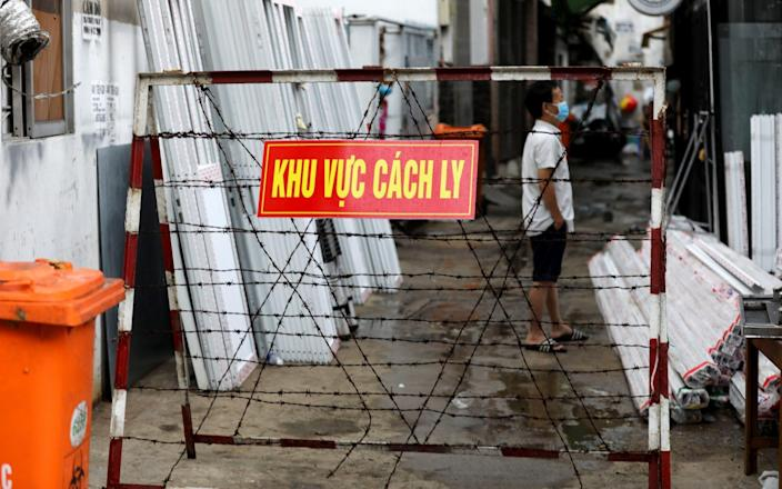 A warning sign is seen outside an area locked in quarantine in Ho Chi Minh city - Reuters