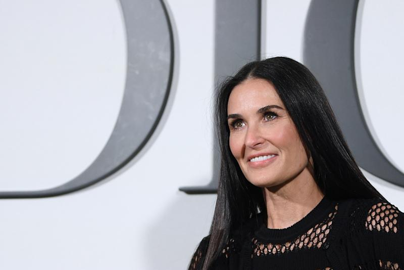 US actress Demi Moore poses during the photocall prior to the Dior Women's Fall-Winter 2020-2021 Ready-to-Wear collection fashion show in Paris, on February 25, 2020. (Photo by Anne-Christine POUJOULAT / AFP) (Photo by ANNE-CHRISTINE POUJOULAT/AFP via Getty Images)
