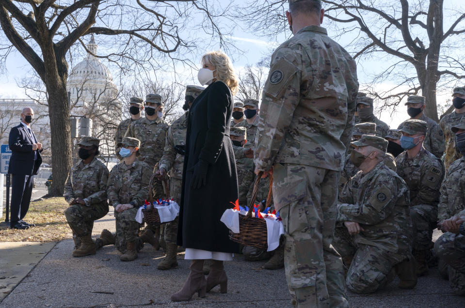 First lady Jill Biden poses for a photograph with members of the National Guard, after surprising them with chocolate chip cookies, Friday, Jan. 22, 2021, at the U.S. Capitol in Washington. (AP Photo/Jacquelyn Martin, Pool)