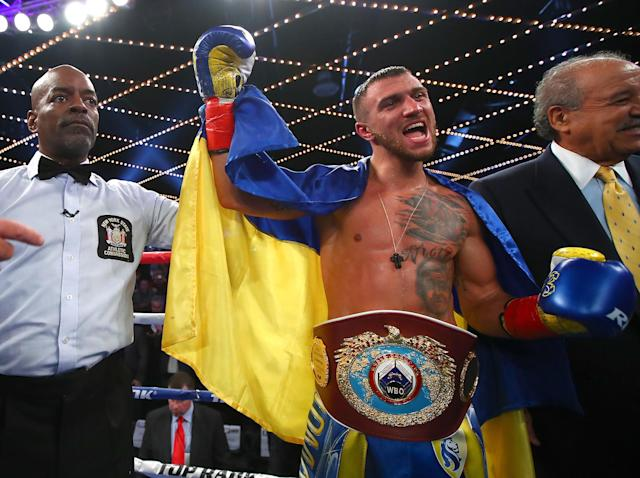 WBO super featherweight champion Vasyl Lomachenko celebrates after stopping Guillermo Rigondeaux after six rounds on Dec. 9 in New York. (Mikey Williams/Top Rank)