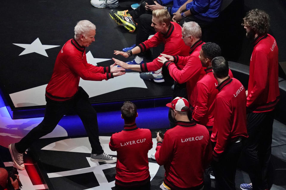 Team World's captain John McEnroe, left, greets his team during introductions before the matches at Laver Cup tennis, Saturday, Sept. 25, 2021, in Boston. (AP Photo/Elise Amendola)