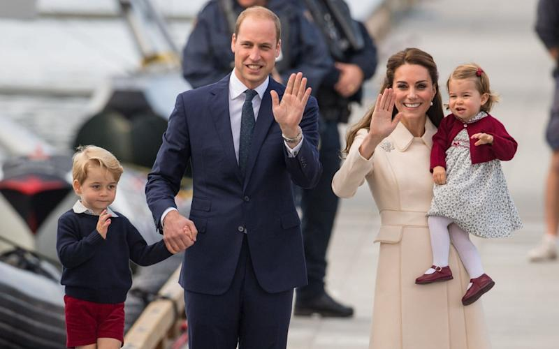Prince George and Princess Charlotte with their parents. - Credit: Dominic Lipinski/PA Wire