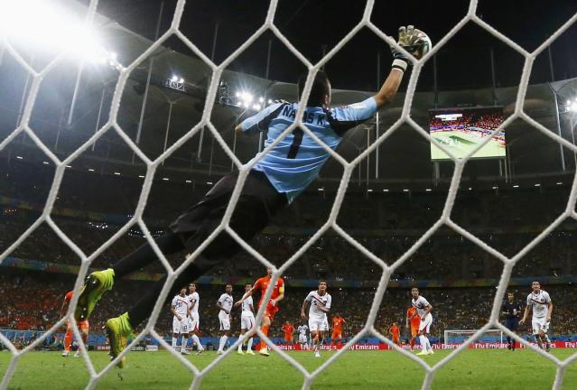 Costa Rica's goalkeeper Keilor Navas jumps to save the ball during their 2014 World Cup quarter-finals against the Netherlands at the Fonte Nova arena in Salvador July 5, 2014. REUTERS/Marcos Brindicci (BRAZIL - Tags: SOCCER SPORT WORLD CUP)