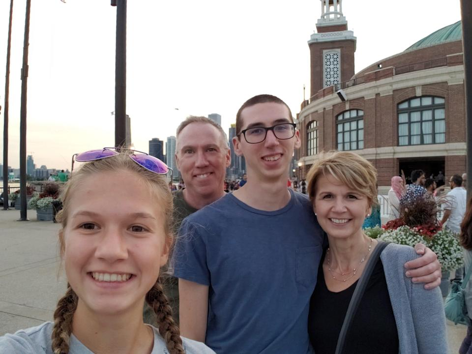 Alex Kearns (center in glasses) killed himself thinking he had suffered huge financial losses on the Robinhood website. His family filed a wrongful death suit against the company, which was settled. Also pictured are Alex's sister Sydney (front), father Dan and mom Dorothy.