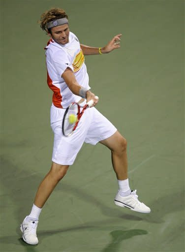 Mardy Fish, of the United States, returns the ball to Bjorn Phau, of Germany, during a match in the Citi Open tennis tournament, Tuesday, July 31, 2012, in Washington. (AP Photo/Nick Wass)