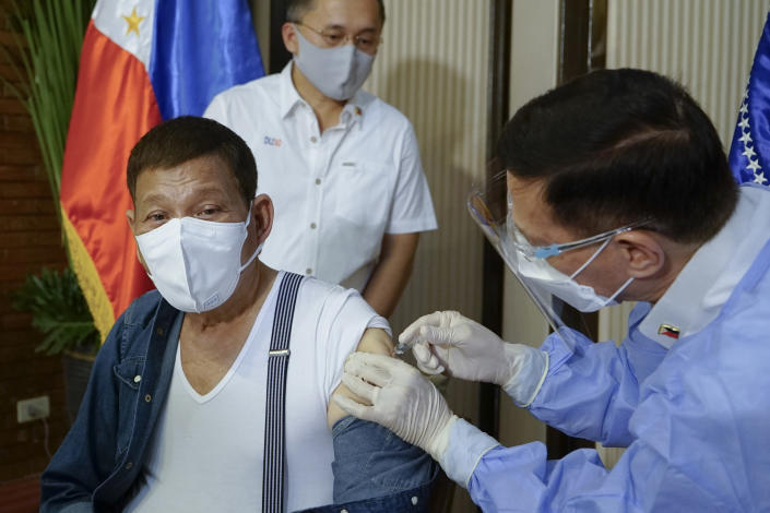 In this photo provided by the Malacanang Presidential Photographers Division, Philippine President Rodrigo Duterte, left, is inoculated with China's Sinopharm COVID-19 vaccine by Health Secretary Fracisco Duque III at the Malacanang presidential palace in Manila, Philippines Monday, May 3, 2021. The Philippine president has asked China to get back 1,000 doses of donated Sinopharm vaccine after facing criticisms for allowing himself to be injected with it although it has not yet been authorized for public use in the country. (King Rodriguez/Malacanang Presidential Photographers Division via AP)