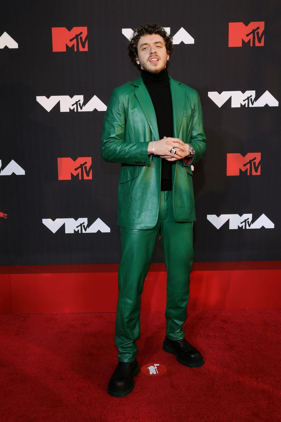 <p>Jack Harlow wore a leather green suit over a black turtleneck. </p>