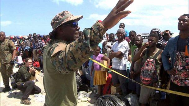PHOTO: Senior Lt. William Sturrup of the Royal Bahamian Defense Force tells desperate evacuees to be patient as they wait to leave the Abaco Islands after they were hit by Hurricane Dorian. (ABC News)