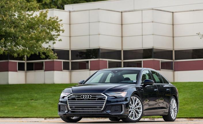 """<p><a href=""""https://www.caranddriver.com/audi/a6"""" rel=""""nofollow noopener"""" target=""""_blank"""" data-ylk=""""slk:The 2019 Audi A6"""" class=""""link rapid-noclick-resp"""">The 2019 Audi A6</a>'s new Mild Hybrid Electric Vehicle (MHEV) system is the same setup used by the swoopier-styled A7, as well as the larger A8 sedan. A small battery under the back seat powers a motor/generator tied to the engine's crankshaft via a belt drive and delivers smooth, barely noticeable engine restarts after it's shut down to save fuel when the vehicle is stopped in traffic or at stoplights.<br></p>"""