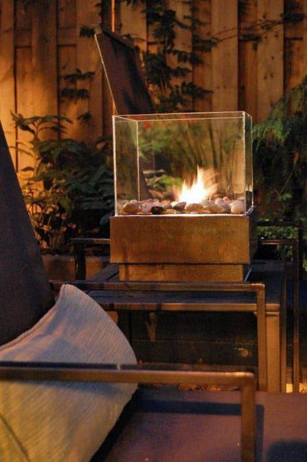 """<p>This exquisite little fire pit is lined with a wire mesh bottom to hold stones and a gel fuel can.</p><p><strong>Get the tutorial at <a href=""""https://www.theartofdoingstuff.com/how-to-make-a-personal-fire-pit-for-cheap/"""" rel=""""nofollow noopener"""" target=""""_blank"""" data-ylk=""""slk:The Art of Doing Stuff"""" class=""""link rapid-noclick-resp"""">The Art of Doing Stuff</a>.</strong></p><p><a class=""""link rapid-noclick-resp"""" href=""""https://www.amazon.com/Royal-Imports-Decorative-Ornamental-Landscaping/dp/B0143IX8W6/?tag=syn-yahoo-20&ascsubtag=%5Bartid%7C10050.g.31966151%5Bsrc%7Cyahoo-us"""" rel=""""nofollow noopener"""" target=""""_blank"""" data-ylk=""""slk:SHOP RIVER ROCKS"""">SHOP RIVER ROCKS</a></p>"""