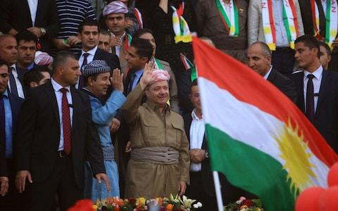 Iraqi Kurdish President Masoud Barzani salutes the crowd while attending a rally to show their support for the September 25 independence referendum - Credit: Reuters