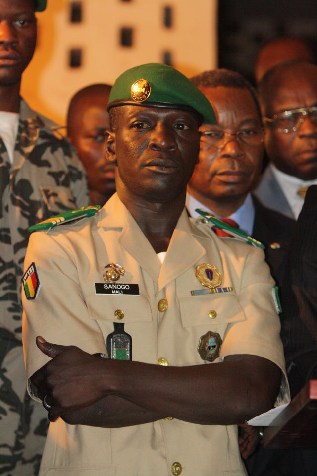 Coup leader Capt. Amadou Haya Sanogo stands at junta headquarters during an address to the press, in Kati, outside Bamako, Mali, Friday, April 6, 2012. Under intense pressure from the nations bordering Mali, Sanogo, the junior officer who seized control of the country in a coup last month signed an accord agreeing to return the country to constitutional rule. The announcement was made late Friday, only hours after separatist rebels in the country's distant north declared their independence. (AP Photo/Harouna Traore)