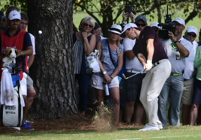 Rory McIlroy hits from rough on the fifth fairway during the first round of the Tour Championship golf tournament Thursday, Sept. 20, 2018, in Atlanta. (AP Photo/John Amis)