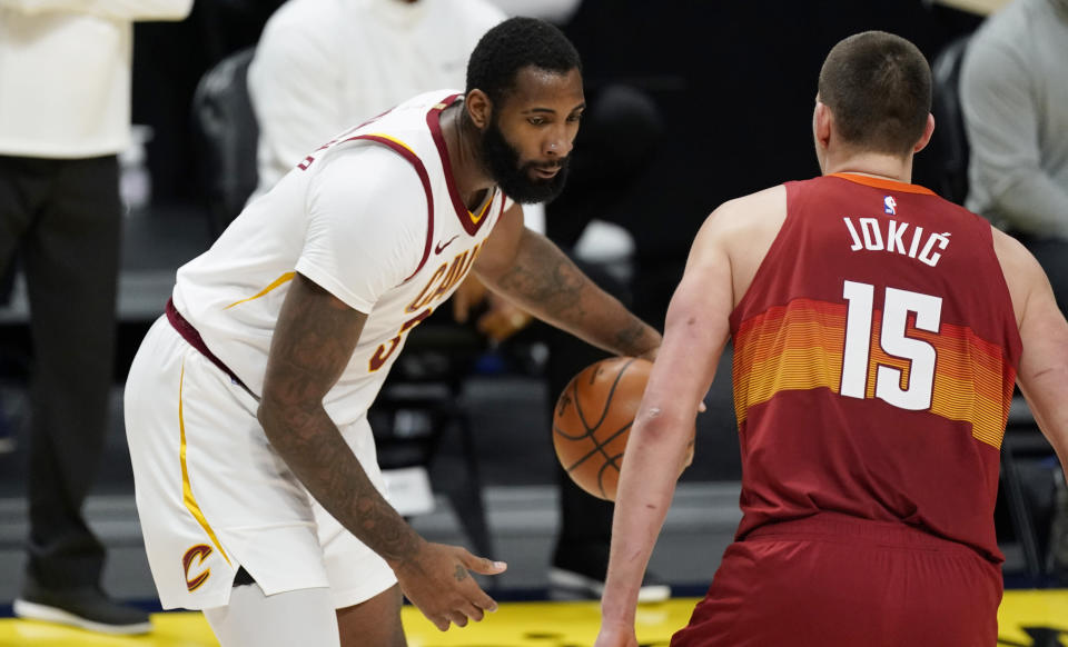 Cleveland Cavaliers center Andre Drummond, left, works the ball inside as Denver Nuggets center Nikola Jokic defends in the second half of an NBA basketball game Wednesday, Feb. 10, 2021, in Denver. (AP Photo/David Zalubowski)