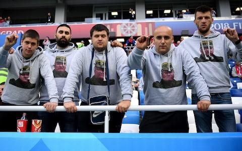 <span>Serbia supporters displayed images of war criminal Ratko Mladic pictures on their jerseys </span> <span>Credit: GETTY IMAGES </span>
