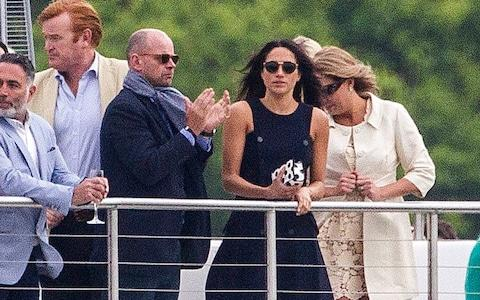 Meghan Markle watches Prince Harry play polo at Coworth Park - Credit: David Hartley