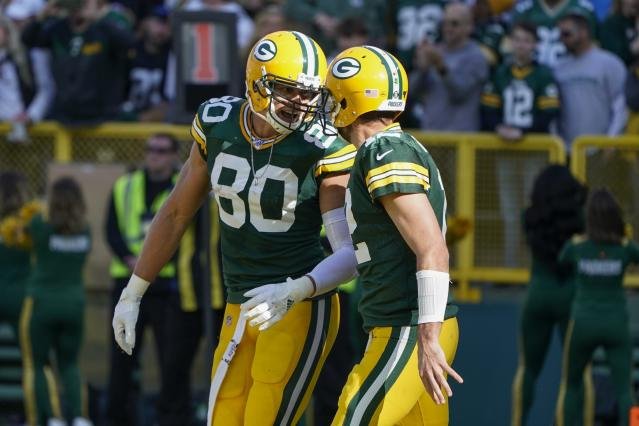 Green Bay Packers' Jimmy Graham celebrates a touchdown catch with Aaron Rodgers (12). (AP Photo/Morry Gash)