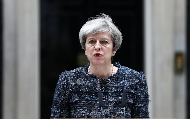 Theresa May speaks outside Downing Street - Reuters