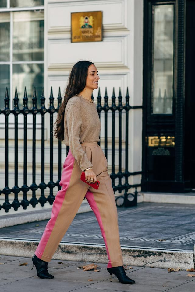 <p>Wear heeled ankle boots with trousers that graze the ankle, so most of your boot is still on display.</p>
