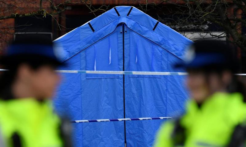 Police officers stand guard in front of a forensics tent in a cordoned off area in the centre of Salisbury.