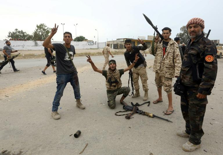 Fighters with Libyan internationally-recognised government have been fighting against Haftar since April (AFP Photo/Mahmud TURKIA)