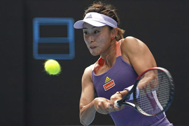 China's Wang Qiang returns a backhand to Serena Williams of the U.S. in their third round singles match at the Australian Open tennis championship in Melbourne, Australia, Friday, Jan. 24, 2020. (AP Photo/Lee Jin-man)