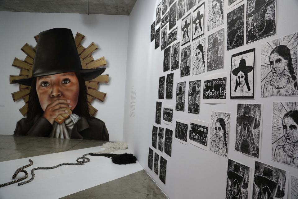 Images of Tupac Amaru and wife Micaela Bastidas are displayed at the Place of Memory, Tolerance and Social Inclusion museum in Lima, Peru, Saturday, May 16, 2021. Tupac Amaru was a muleteer and trader who claimed descent from Inca royals, led an Andean revolt against Spanish colonial rule and was executed on May 18, 1781. (AP Photo/Martin Mejia)
