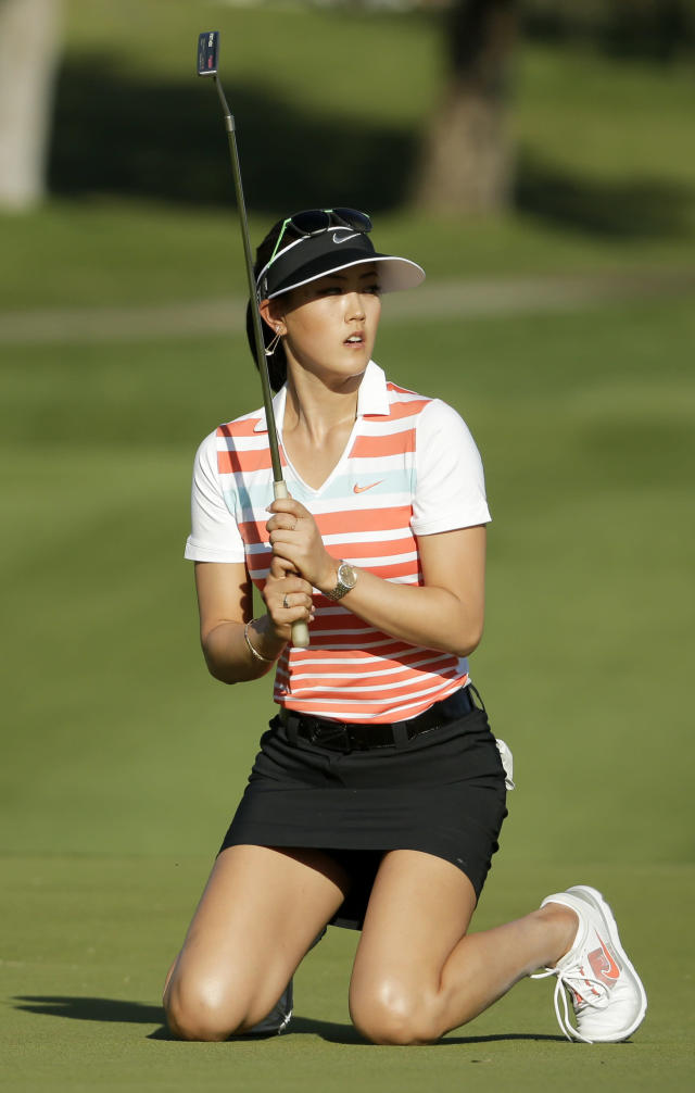 Michelle Wie reacts after missing a putt on the 15th hole during the third round of the Kraft Nabisco Championship golf tournament Saturday, April 5, 2014, in Rancho Mirage, Calif. (AP Photo/Chris Carlson)