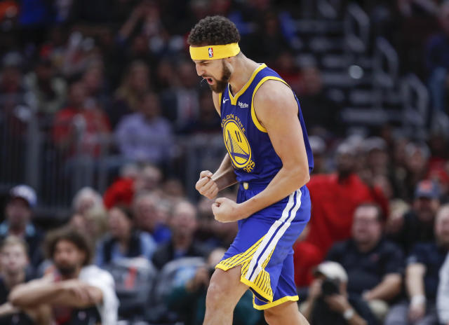 Golden State Warriors guard Klay Thompson celebrates after hitting his record 14th 3-pointer against the Chicago Bulls on Monday night. (AP Photo/Kamil Krzaczynski)