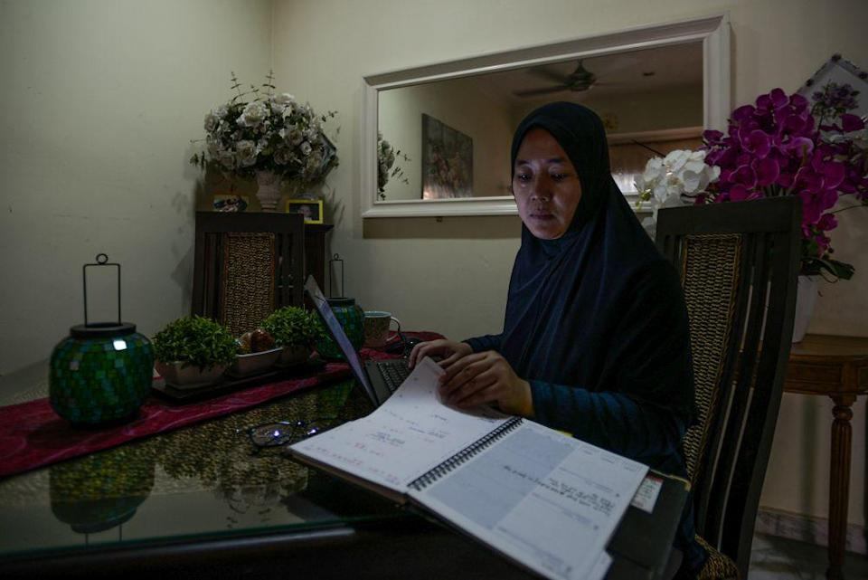 A woman works from home amid the movement control order in Shah Alam April 15, 2020. — Picture by Miera Zulyana