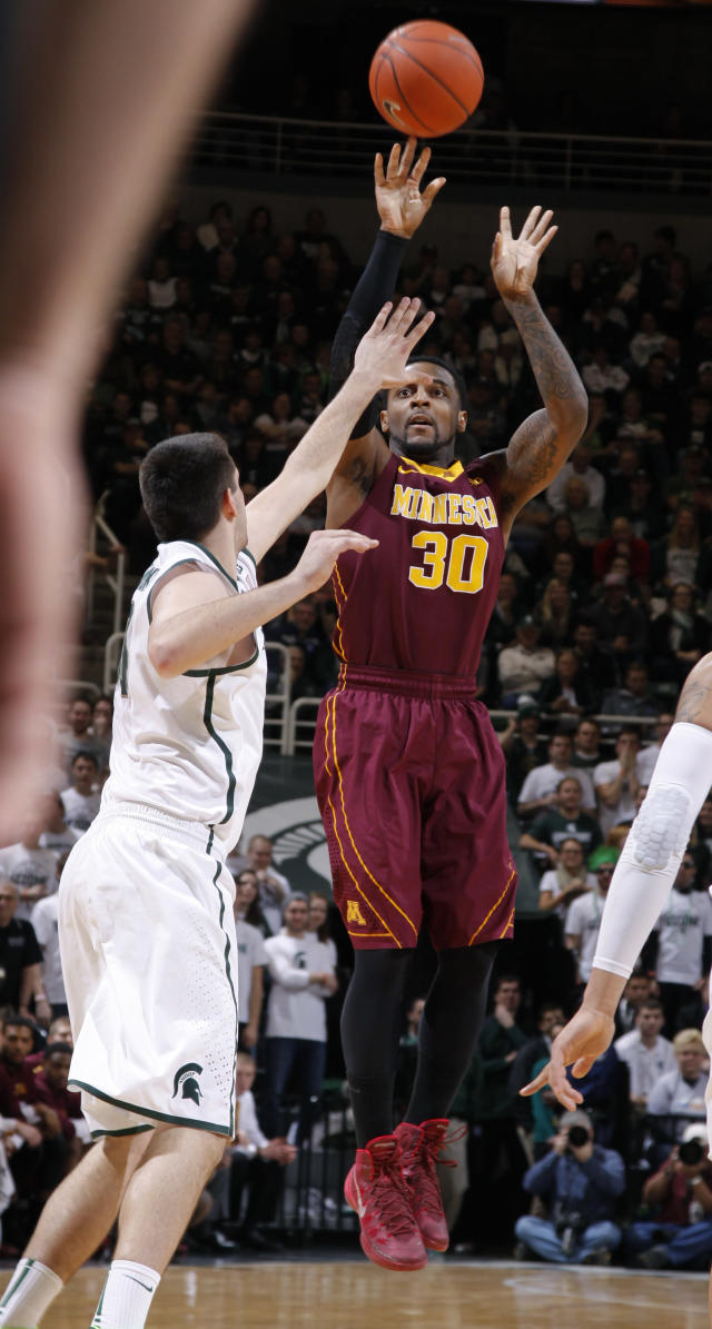 Minnesota's Malik Smith (30) shoots against Michigan State's Kenny Kaminski during the first half of an NCAA college basketball game, Saturday, Jan. 11, 2014, in East Lansing, Mich. (AP Photo/Al Goldis)