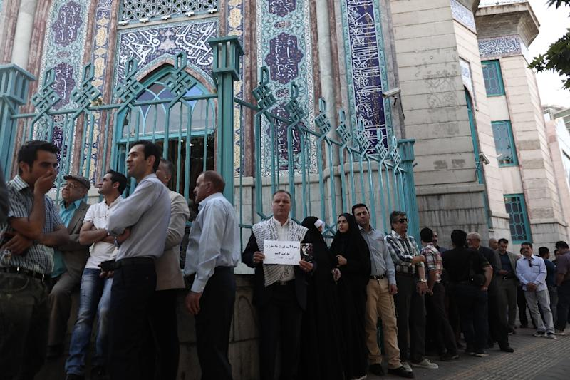 Iranians queue to vote in an election seen as a verdict on the rule of President Hassan Rouhan