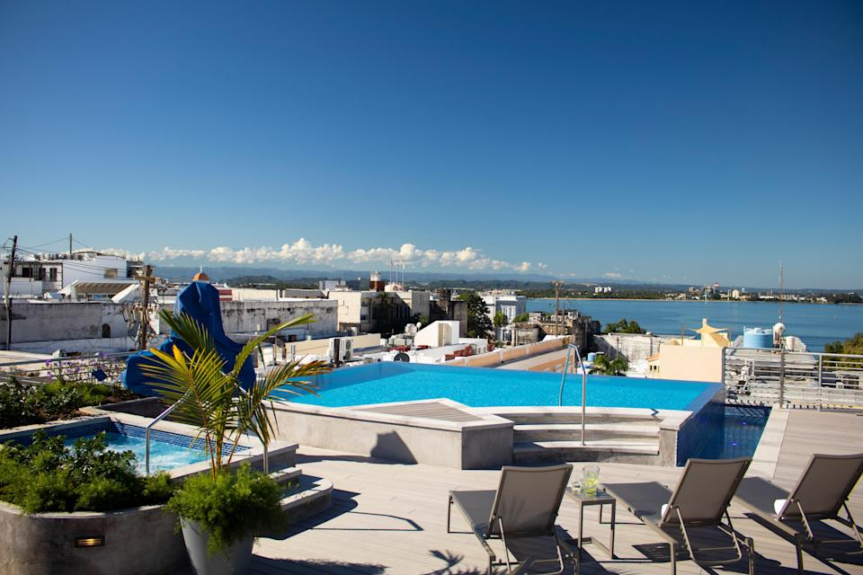 """Rooftop pools often mean you're swimming with a view of cityscapes and neighboring skyscrapers—not the case at the historic <a href=""""https://www.cntraveler.com/hotels/san-juan/palacio-provincial?mbid=synd_yahoo_rss"""" rel=""""nofollow noopener"""" target=""""_blank"""" data-ylk=""""slk:Palacio Provincial"""" class=""""link rapid-noclick-resp"""">Palacio Provincial</a>. From this rooftop pool, you'll be treated to views over Old San Juan and over San Juan Bay, for a truly transporting vista that harkens to another time."""