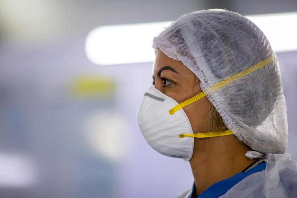RIO DE JANEIRO, BRAZIL - JUNE 08: A medical staff member  wearing a mask works at Parque dos Atletas (Athlete's Village) field hospital amidst the coronavirus (COVID-19) pandemic on June 8, 2020 in Rio de Janeiro, Brazil. The emergency field hospital assist SUS (Brazil's publicly funded health care system) patients infected with the coronavirus (COVID-19). The structure has 200 beds, of which 150 are for hospitalization and 50 for ICU, these equipped with devices necessary for highly complex patients, such as mechanical ventilators, monitors and infusion pumps. (Photo by Buda Mendes/Getty Images)