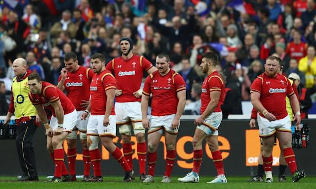 """<span class=""""element-image__caption"""">The Wales team struggle to comprehend their loss in the 100th minute.</span> <span class=""""element-image__credit"""">Photograph: Michael Steele/Getty Images</span>"""