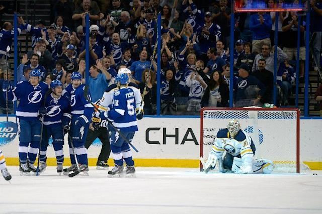 Tampa Bay Lightning center Tyler Johnson (9), second from left, is congratulated by teammates right wing Richard Panik, left, center Alex Killorn (17) and center Valtteri Filppula (51) after scoring past Buffalo Sabres goalie Ryan Miller (30) during the first period of an NHL hockey game in Tampa, Fla., Saturday, Oct. 26, 2013. (AP Photo/Phelan M. Ebenhack)