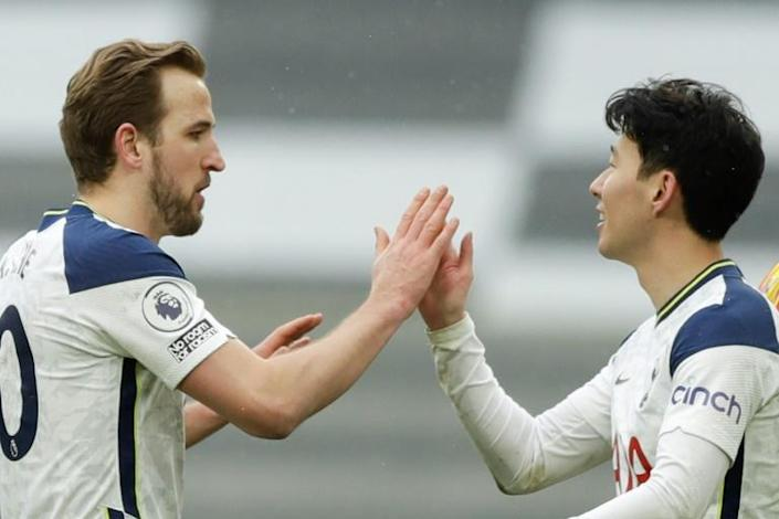 Tottenham's Harry Kane (L) celebrates with Son Heung-min