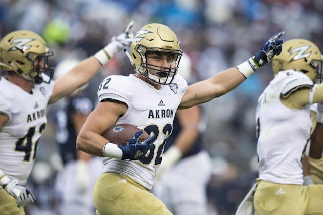 """UNIVERSITY PARK, PA – SEPTEMBER 02: <a class=""""link rapid-noclick-resp"""" href=""""/ncaaf/players/227965/"""" data-ylk=""""slk:Zach Guiser"""">Zach Guiser</a> #32 of the <a class=""""link rapid-noclick-resp"""" href=""""/ncaab/teams/aac/"""" data-ylk=""""slk:Akron Zips"""">Akron Zips</a> celebrates a interception in the end zone during the first quarter against the <a class=""""link rapid-noclick-resp"""" href=""""/ncaab/teams/paf/"""" data-ylk=""""slk:Penn State Nittany Lions"""">Penn State Nittany Lions</a> on September 2, 2017 at Beaver Stadium in University Park, Pennsylvania. (Photo by Brett Carlsen/Getty Images)"""