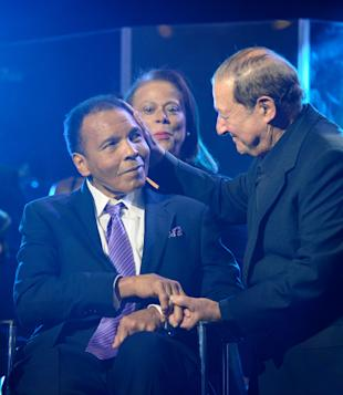 Muhammad Ali shakes hands with Bob Arum during a birthday celebration for Ali in 2012. (Getty)