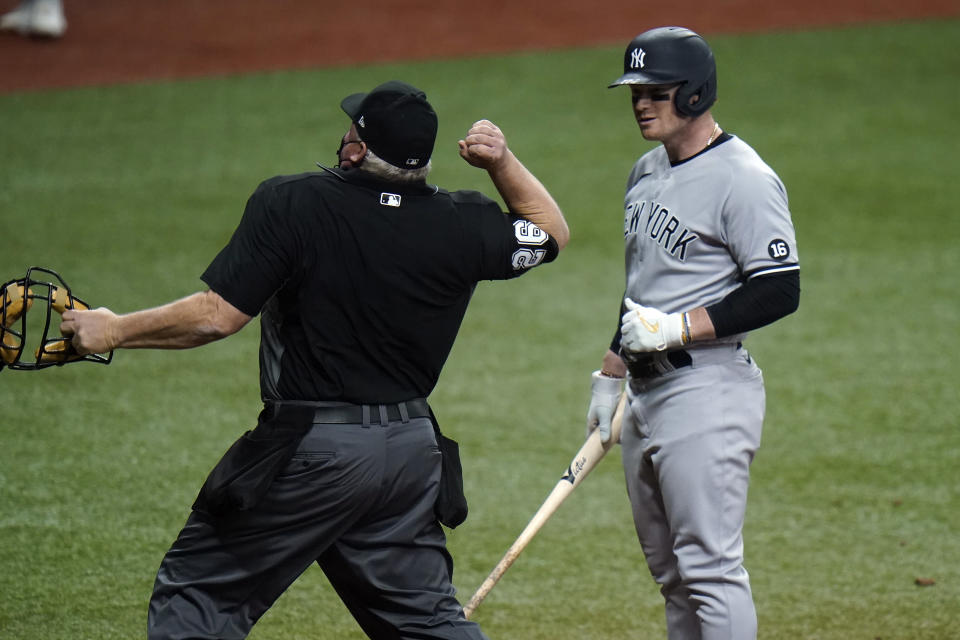 New York Yankees' Clint Frazier, right, gets thrown out of the game by home plate umpire Bill Miller after Frazier struck out against Tampa Bay Rays pitcher Ryan Yarbrough during the fifth inning of a baseball game Wednesday, May 12, 2021, in St. Petersburg, Fla. (AP Photo/Chris O'Meara)