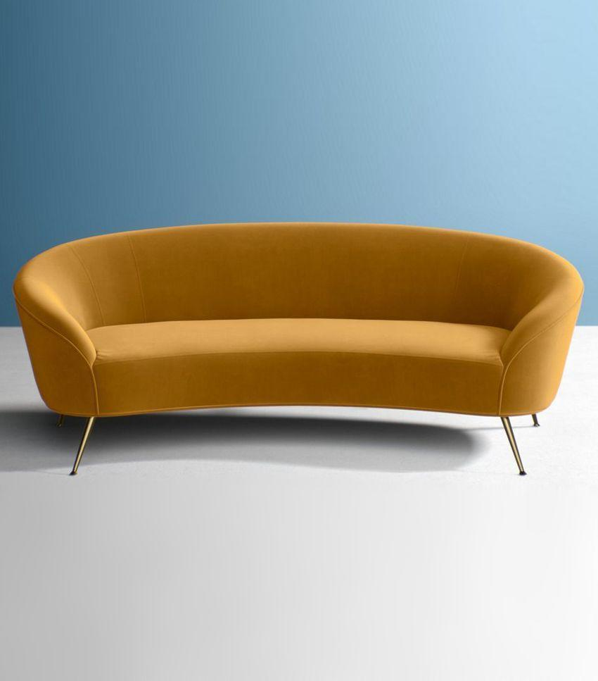 Ochre and sepia tones continue to pop up in the décor space. This rounded sofa nails the trend.
