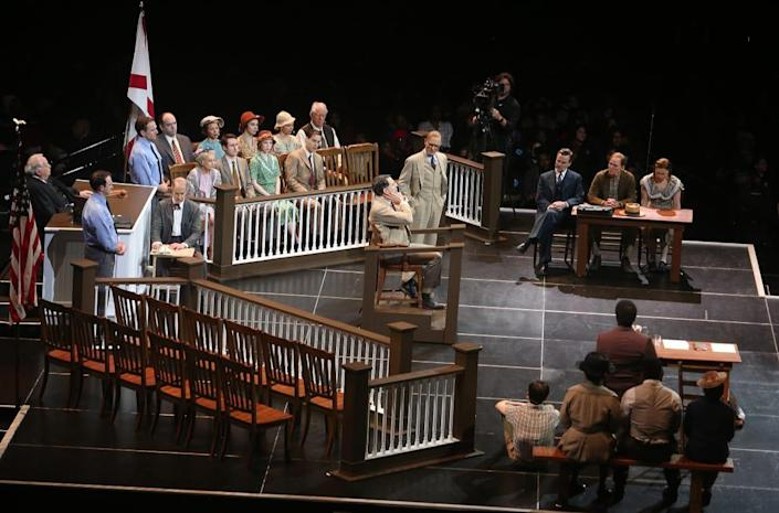 """<div class=""""inline-image__caption""""> <p>Dakin Matthews, Ed Harris, Christopher Innvar and Kyle Scatliffe perform during Harper Lee's """"To Kill A Mockingbird"""", a new play by Aaron Sorkin at Madison Square Garden on February 26, 2020 in New York City. The performance was the first-ever Broadway play performed at Madison Square Garden with an entirely free performance for 18,000 New York City public school students.</p> </div> <div class=""""inline-image__credit""""> Bruce Glikas/Getty </div>"""