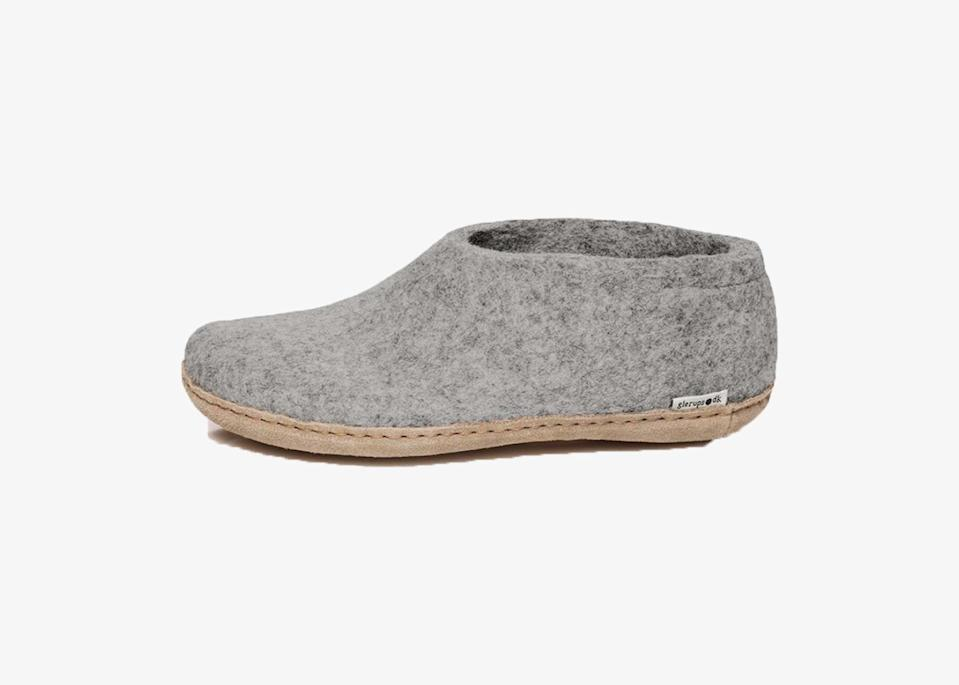"""We swear by these Danish felt shoes that actually mold to fit the shape of your feet over time. They're flexible, so your feet don't get cramped, and they provide plenty of warmth while staying dry thanks to the moisture-absorbent 100 percent pure natural wool. Great at home, on the road, or even padding around the <a href=""""https://www.cntraveler.com/galleries/2014-12-05/america-s-best-ski-resorts-readers-choice-awards-2014?mbid=synd_yahoo_rss"""" rel=""""nofollow noopener"""" target=""""_blank"""" data-ylk=""""slk:ski lodge"""" class=""""link rapid-noclick-resp"""">ski lodge</a>, Glerups come in a nice range of neutral colors including gray, charcoal, forest green, and cranberry. This particular design is offered with a soft calfskin or natural rubber sole. $95, Backcountry. <a href=""""https://www.backcountry.com/glerups-shoe-slipper"""" rel=""""nofollow noopener"""" target=""""_blank"""" data-ylk=""""slk:Get it now!"""" class=""""link rapid-noclick-resp"""">Get it now!</a>"""