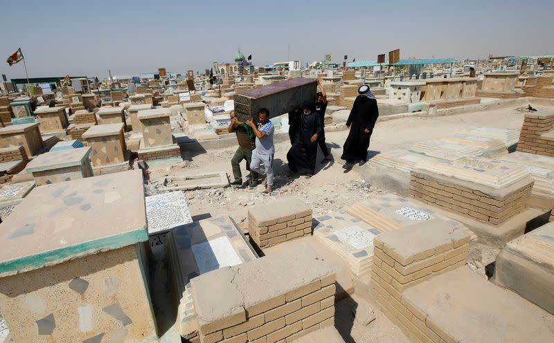Iraqis flock to Najaf's COVID-19 cemetery to move their dead elsewhere