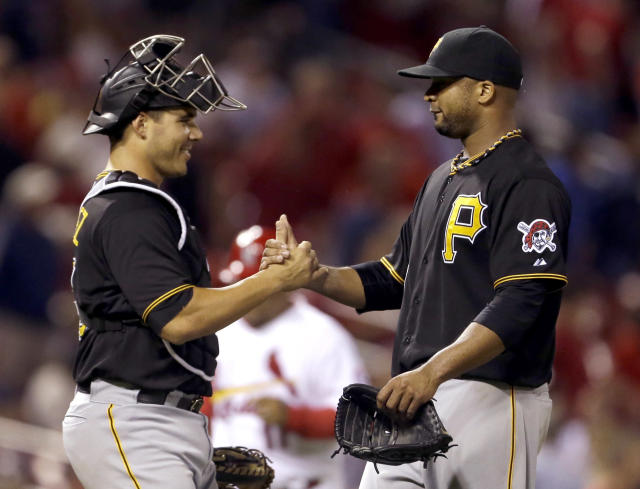 Pittsburgh Pirates starting pitcher Francisco Liriano, right, and catcher Tony Sanchez celebrate after the final out of a baseball game against the St. Louis Cardinals Wednesday, Aug. 14, 2013, in St. Louis. Liriano threw a complete game in the Pirates' 5-1 victory. (AP Photo/Jeff Roberson)